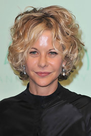 Meg Ryan attended the Chopard 150th anniversary party wearing her hair in voluminous curls.