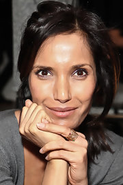 Padma Lakshmi accessorized with stackable gold and gemstone rings when she attended the Costello Tagliapietra fashion show.