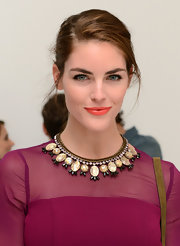 Hilary Rhoda's coral lipstick totally lit up her face.