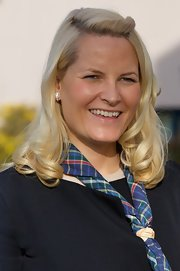 Princess Mette-Marit attended the International Scouts Gathering wearing a half-up hairstyle with curly ends.