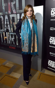 Stana Katic highlighted her look with a blue and gold paisley-print silk scarf when she attended the premiere of 'Zero Dark Thirty.'