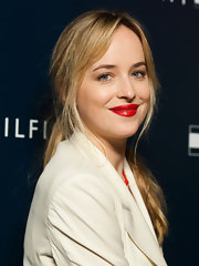 Dakota Johnson swiped of some red-hot lipstick for a sexy beauty look.