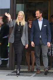 Princess Mette-Marit completed her outfit with a pair of black patent booties.