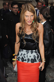 Anna dello Russo wore some colorful Creart II bangles with her Balenciaga dress during the Balmain fashion show.