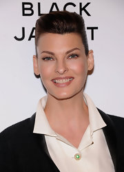 Linda Evangelista had her hair tied up and teased for a Chanel event.
