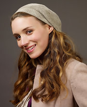 Rooney Mara tamed her curls with a beige knit beanie for her Sundance portrait.