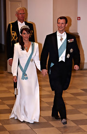 Princess Marie opted for a simple yet sophisticated white V-neck gown when she attended Queen Margrethe's 70th birthday celebrations.