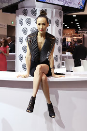 Maggie Q teamed black lace peep-toe booties with a futuristic LBD for day 2 of Comic-Con.