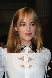 Dakota Johnson was casually coiffed with straight locks and wispy bangs at the Viktor & Rolf fashion show.
