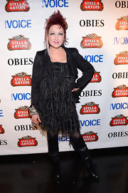 Cyndi Lauper had her legs covered with a pair of knee-high boots.