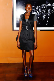 Alek Wek chose a pair of strappy blue platform sandals to complete her ensemble.