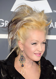 Cyndi Lauper had her highlighted hair tied up in a messy do for the Grammys.
