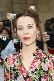 Ulyana Sergeenko went for classic styling with a pair of cameo earrings.