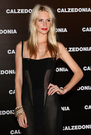 Poppy Delevingne paired a layered pearl bracelet with a sheer black dress for the Calzedonia Summer Show.