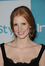 Jessica Chastain polished off her ensemble with a colorful pair of dangling gemstone earrings.