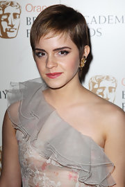 Emma Watson teamed a breezy pixie with a one-shoulder gown for the Orange British Academy Film Awards.