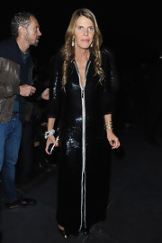 Anna dello Russo went for exotic elegance in a fully sequined black tunic dress by Giorgio Armani during the Saint Laurent fashion show.