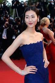 Liu Wen looked super elegant with her diamond bracelets and strapless dress at the 'All is Lost' Cannes premiere.