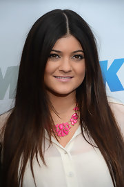 Kylie Jenner dolled up her outfit with a pink statement necklace.