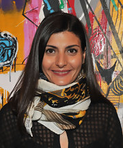 Giovanna Battaglia kept cozy with a voluminous patterned scarf.