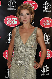 Clotilde Courau paired a red mani with a beaded gold dress for an event at Le Crazy Horse.