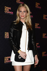 Poppy Delevingne attended the Chime for Change concert carrying a Gucci 1973 suede shoulder bag.