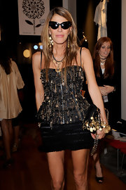 Anna dello Russo topped off her look with a pair of modernized cateye sunnies.