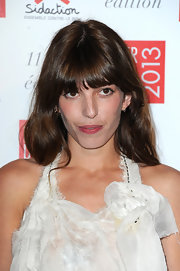 Lou Doillon looked youthful with her eye-skimming bangs and loose waves during the Sidaction Gala.