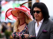 Never failing to look extravagant, Shannon Tweed donned a ribbon and feather detailed sun hat at the Preakness Stakes.