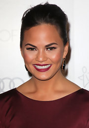 Chrissy Teigen matched her dress with a raspberry lip color.