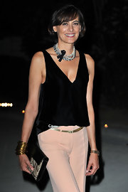 Ines de la Fressange styled her look with a layer of pearl necklaces at Paris Fashion Week.