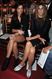 Carine Roitfeld styled her black outfit with white lace-up peep-toe booties when she attended the John Galliano fashion show.