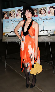 Jena Malone added an extra pop of bright color with a yellow bow purse.