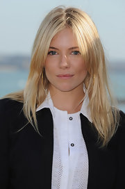 Sienna Miller wore her hair in casual center-parted layers during the Dinard British Film Festival jury photocall.