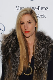 Joanna Hillman styled her fur coat with an oversized gold pendant necklace for total glamour.