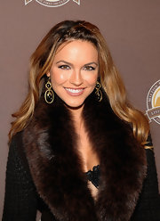 Chrishell Stause got glam with a pair of dangling gemstone earrings for the New York premiere of the Milton Hershey School documentary.