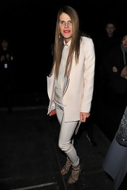 Anna dello Russo's pale-pink Givenchy pantsuit was a play on proportions with its loose-fit jacket and sexy skinny pants.