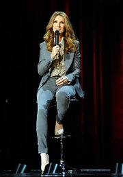 Celine Dion teamed nude peep-toe pumps with jeans and a blazer for a news conference in Las Vegas.