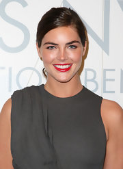 Hilary Rhoda swiped on some bright red lipstick for a splash of color to her gray outfit.