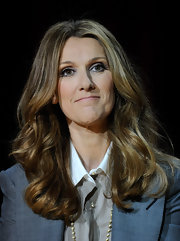 Celine Dion wore her hair in bouncy waves while attending a news conference in Las Vegas.