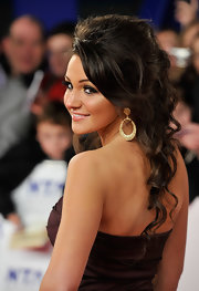 Michelle Keegan went the sweet and romantic route with this loose, wavy half-up style during the National Television Awards.