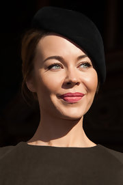 Ulyana Sergeenko looked very French-chic wearing this black beret at the Stella McCartney fashion show.