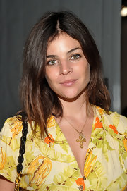 Julia Restoin-Roitfeld styled her outfit with a gold cross pendant necklace during the Theyskens' Theory fashion show.