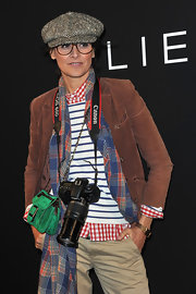 Ines de la Fressange donned a geeky smart ensemble featuring a corduroy jacket at the Elie Saab fashion show.