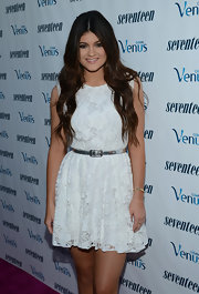 Kylie Jenner paired her little white lace dress with a silver belt for Seventeen Magazine's September issue celebration.