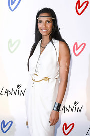 Padma Lakshmi styled her white dress with a gold chain and flower belt by Chanel for the Lanvin Halloween Extravaganza.