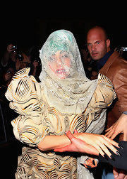 Lady Gaga teamed black mani with a heavily textured frock for a night out in Sydney.