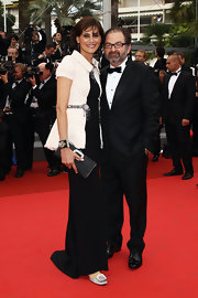 Ines de la Fressange carried a textured leather purse at the 'Habemus Papam' premiere.