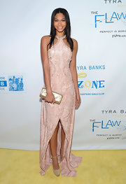 Chanel Iman added some shine via a metallic gold clutch.