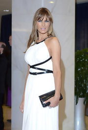 Melania Trump accessorized with a black croc-embossed clutch to match the harness of her Grecian gown at the 2011 White House Correspondents' Association Dinner.